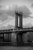 Manhattan bridge with cloudy sky in black and white style, New York