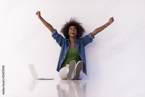 Fotografie, Obraz  african american woman sitting on floor with laptop