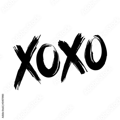 Photo  Phrase XOXO hugs and kisses black brush lettering on a white background