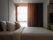 Interior of cozy bedroom in modern design.low lighting and Lens flair in sunlight.