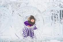 Boy Hiding Behind An Ice Sculpture