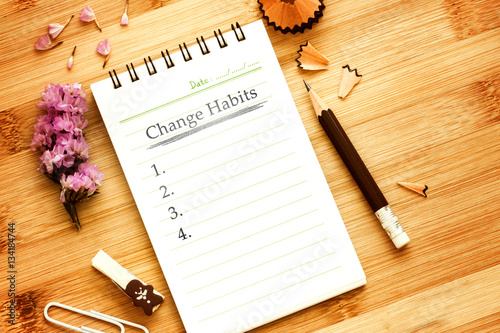 Fotografía  notepad with  pencil  on wooden table for change habits  list co