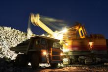 Mining. Excavator Loading Gran...