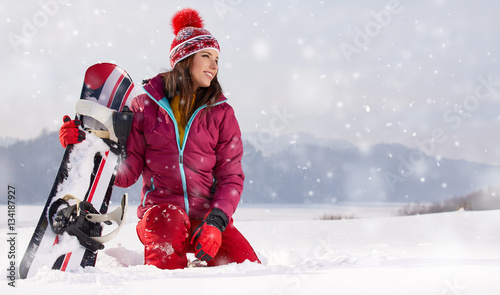 Fotobehang Wintersporten Sport woman snowboarder on snow over snow scenery