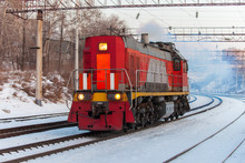 Red Diesel Engine Shunting Locomotive On The Railroad