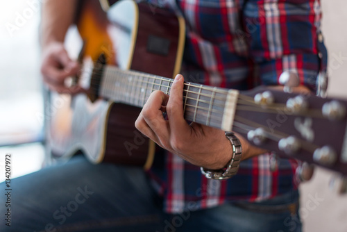 Fotografering  Accord chord, Close up of mens hands playing an acoustic guitar