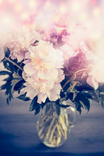 Beautiful Pink Pale Peonies Bunch In Glass Vase On Table With Bokeh Lighting. Romantic Flowers Bouquet, Front View