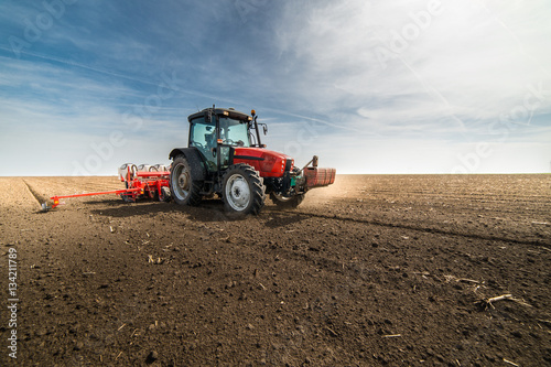 seeding crops at field Canvas Print