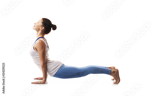 Tuinposter Gymnastiek Flexible young woman practicing yoga and gymnastics.