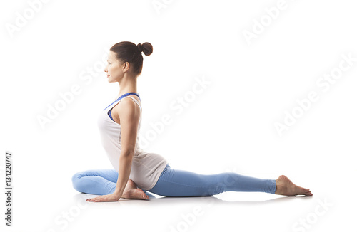 Tuinposter Gymnastiek Young girl engaged in yoga. White background.