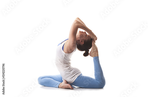Spoed Fotobehang Gymnastiek Young girl engaged in yoga. White background.