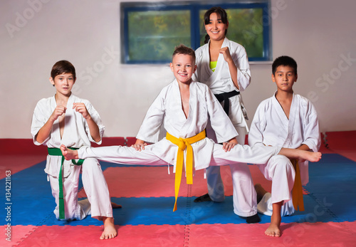 ?hildren demonstrate martial arts working together
