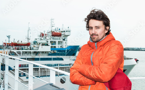 Portrait of a young successful man on the background sea landsca