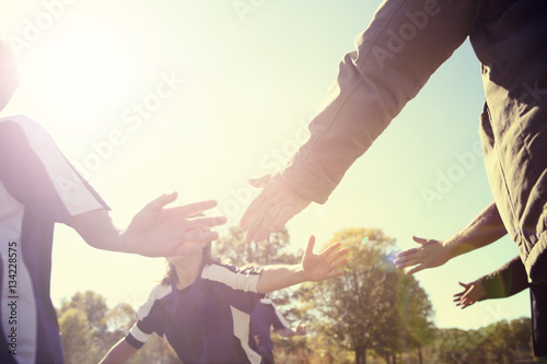 High Five line after a childs soccer game Canvas Print