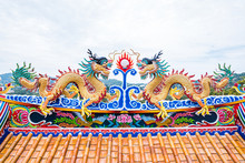 Twin Dragon On Chinese Temple Roof Top