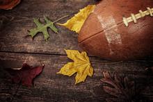 Old Worn Football With Autumn ...