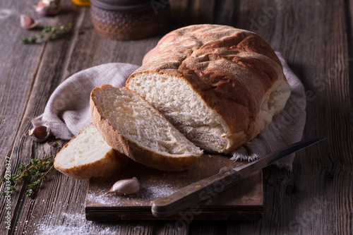 Foto auf Gartenposter Brot freshly baked homemade bread on wooden cutting board