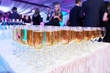 canvas print picture - glasses with white sparkling wine in row at restaurant event
