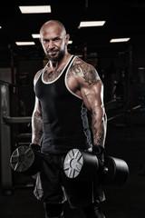 Fototapeta na wymiar Brutal strong athletic men pumping up muscles workout bodybuilding concept background - muscular bodybuilder handsome men doing exercises in gym naked torso