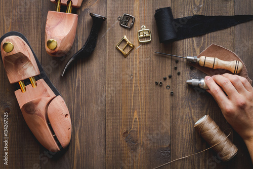 Recess Fitting India cobbler tools in workshop dark background top view
