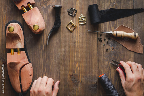 Recess Fitting India cobbler with tools work process dark background top view
