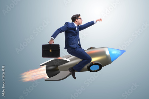 Fotografie, Obraz  Businessman flying on rocket in business concept
