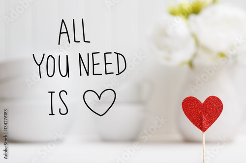 Photo  All You Need Is Love message with small red heart