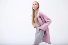 Young Elegant Woman In Trendy Pink Coat.