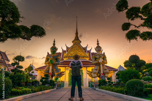 Tourist is watching landmark inside Wat Arun in Bangkok, Thailand.