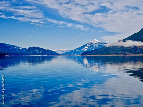Fotografie, Obraz  Blue lake and blue snowy mountains