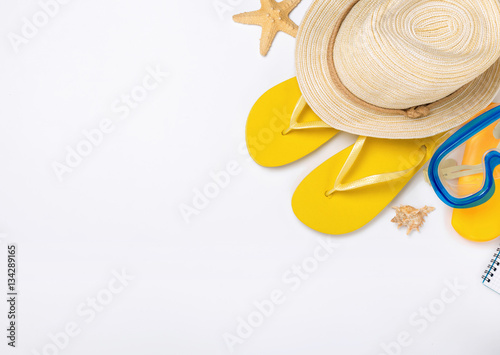 Fotografia  Beach accessories on white background, vacation and travel items