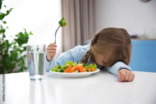 Fotografia, Obraz  Small girl refusing to eat vegetable salad
