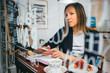 Beautiful businesswoman in cafe with cell