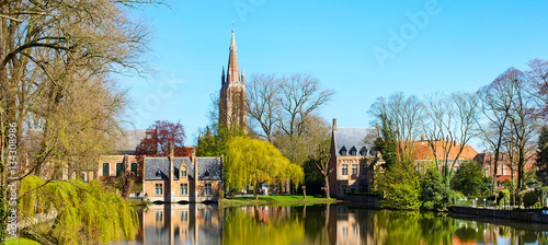 In de dag Brugge Minnewater lake panorama, reflection of gothic Flemish style house, blue sky, spring in Bruges, Belgium
