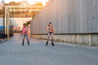 Couple is rollerblading. Young people on urban background. Great idea for active date.