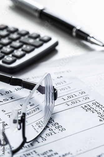 Photo Eyeglasses with calculator on table