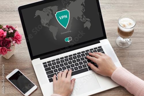 woman holding notebook app vpn creation Internet protocols