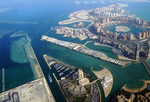 Fotografia, Obraz  Aerial view of the The Pearl Qatar, a new neighborhood in Doha built on an artif