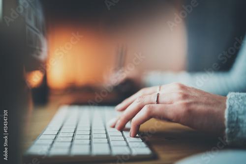 Fotografie, Obraz  Closeup view of female hands typing keyboard