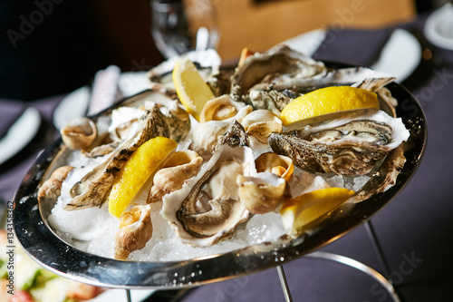 Poster Coquillage platter of fresh organic raw oysters on ice