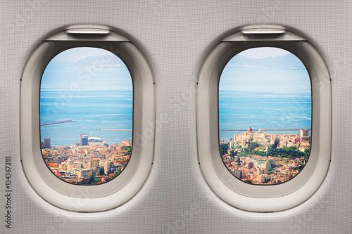 Tuinposter Vliegtuig Ancient mediterranean city viewed from inside an airplane windows