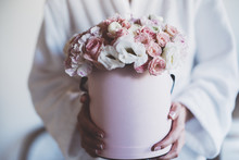 Young Woman Wearing White Cotton Bathrobe And Holding Roses Bouquet, Mock-up Of Hat Box Of Flowers