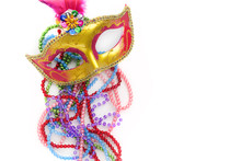 Mardi Gras Mask And Beads On W...