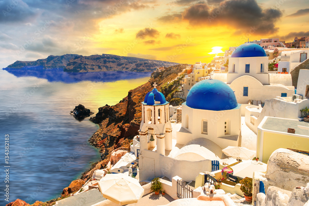 Fototapeta Beautiful sunset over Oia town on Santorini island, Greece