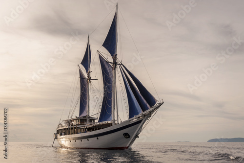 Photo Stands Ship Traditional Indonesian Phinisi Schooner. These boats are made by hand and are designed to ply the waters of the Indonesian archipelago.