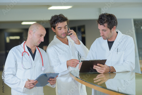 Three medics in discussion Poster
