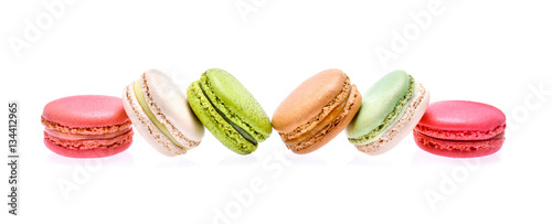 colourful macarons on white background