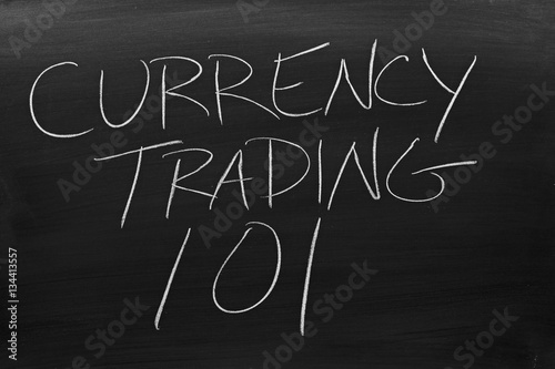 The Words Currency Trading 101 On A Blackboard In Chalk