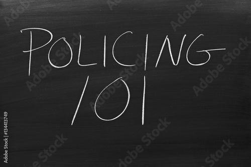 "Fényképezés  The words ""Policing 101"" on a blackboard in chalk"