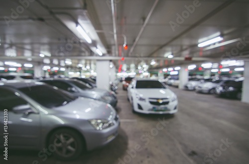 Spoed Foto op Canvas Stadion Abstract blur parking car indoor for background, Color tone effect.